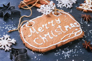 Christmas cookies on black stone background